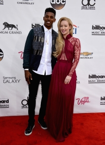 """2014 BILLBOARD MUSIC AWARDS - ARRIVALS - A star-studded lineup of the world's top-selling artists come together to perform their biggest hits on """"2014 Billboard Music Awards."""" The broadcast airs live from Las Vegas at the MGM Grand Garden Arena on SUNDAY, MAY 18 (8:00-11:00 p.m., ET) on the ABC Television Network. (Photo by Frazer Harrison/Getty Images via ABC) NICK YOUNG, IGGY AZALEA"""
