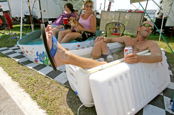 ( l-r) Gale Carpenter, 41, Carrie Carpenter, 34, and Tracy Carpenter, 36, all from Sebring were in the infield and were staying cool in their own way with a kiddie pool and cooler while waiting for the start of the Coke Zero 400 at Daytona International Speedway on Saturday, July 5, 2008. (Barbara V. Perez/Orlando Sentinel)